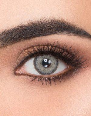 خرید لنز طوسی ته مایه سبز متوسط روشن دور دار برند ویکتوریا